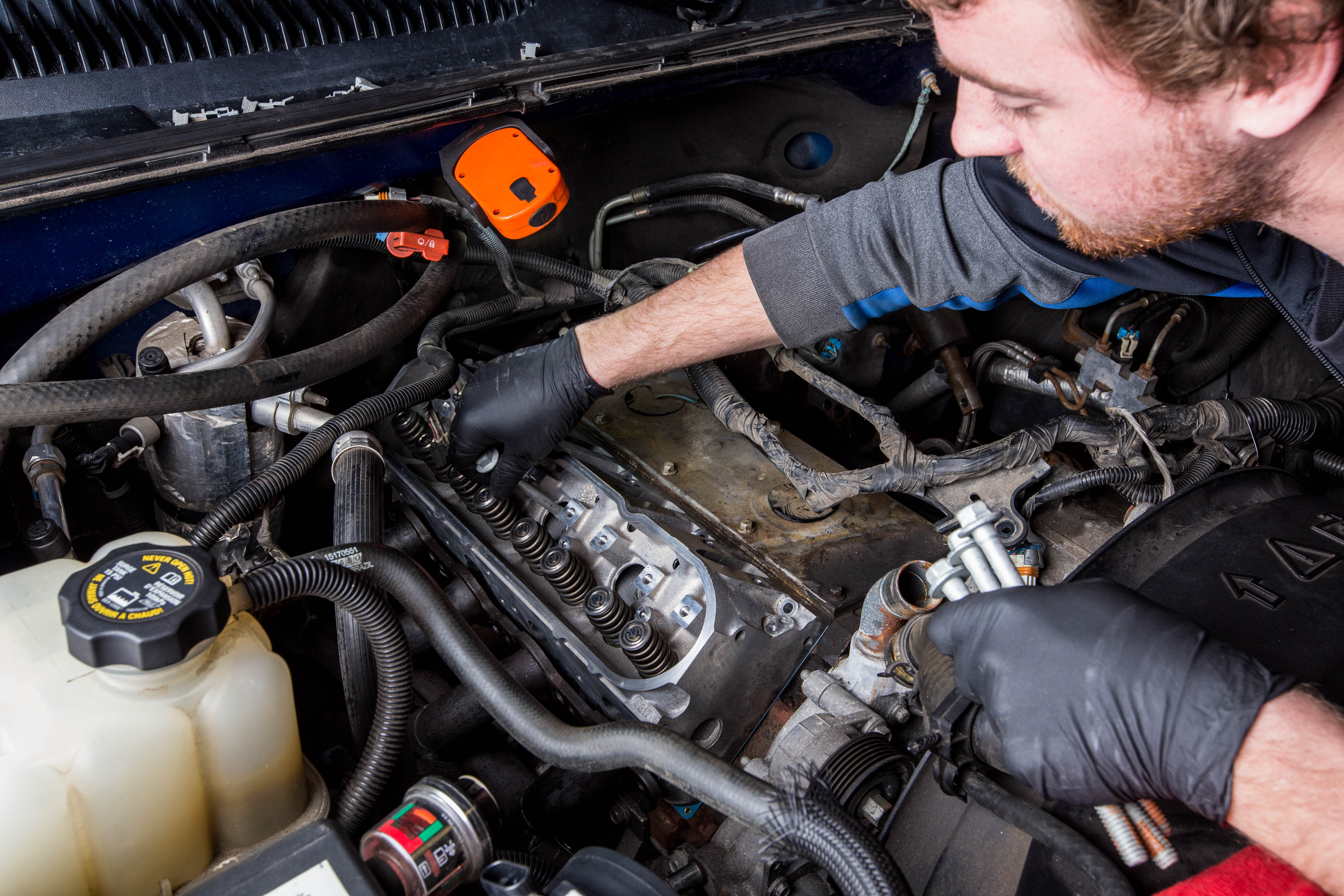 ASE Technician Performing Automotive Service